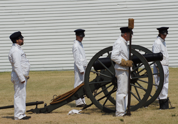Artillery crew demonstrating cannon firing at Fort Scott NHS.