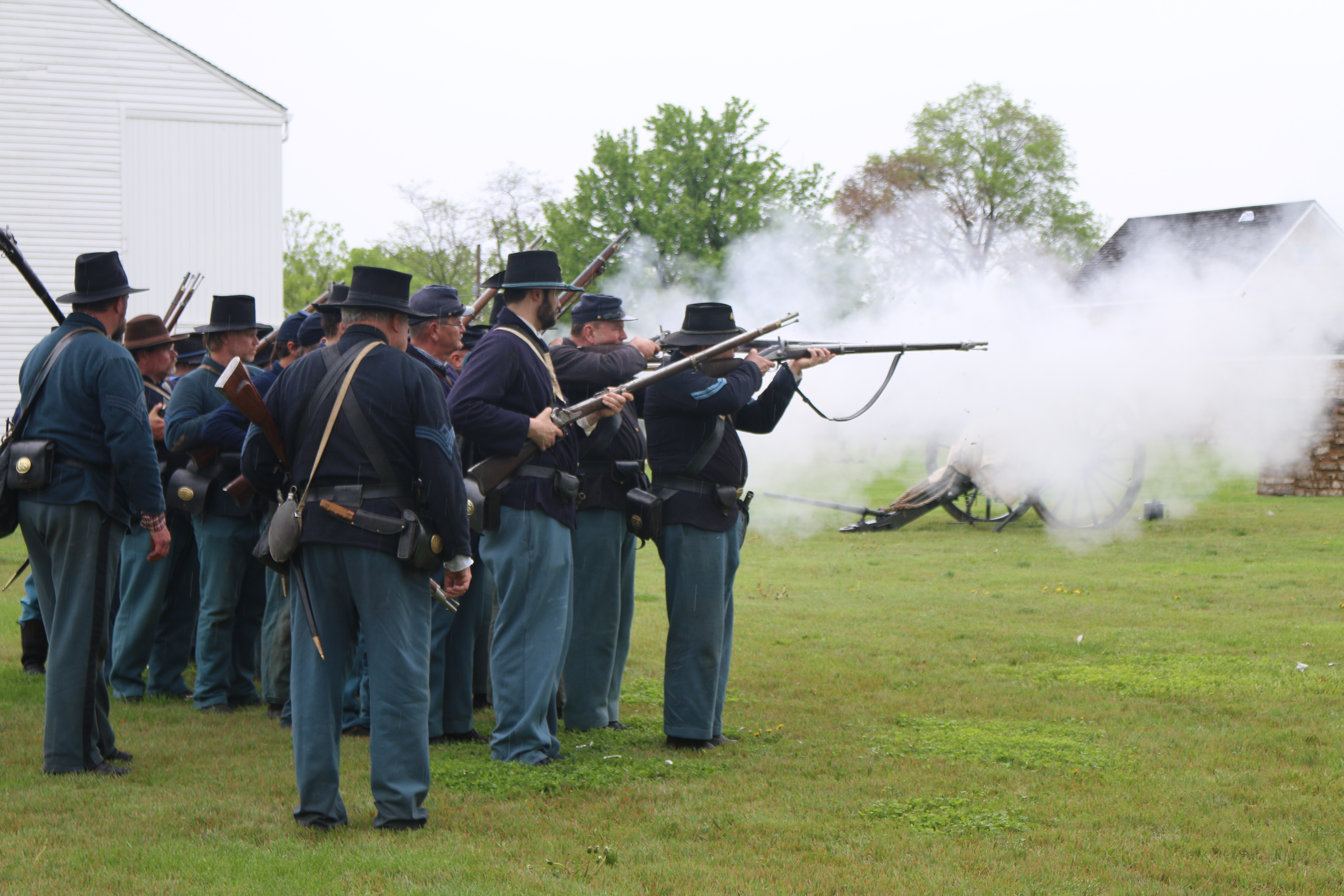 Soldiers firing Civil War Weapons