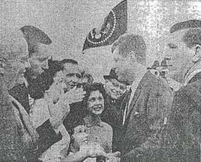 newspaper photo showing JFK greeting crowd at Fort Smith