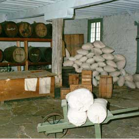 interior of Commissary with exhibit showing containers used by army when the building was a food supply warehouse