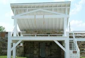 photo of gallows showing two nooses hanging from cross beam