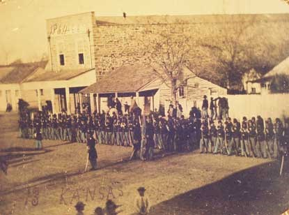 soldiers from 13th Kansas line up in downtown Fort Smith in front of commercial buildings