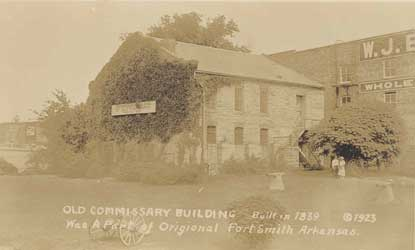 sepia tone photo of Commissary with handwritten text on front