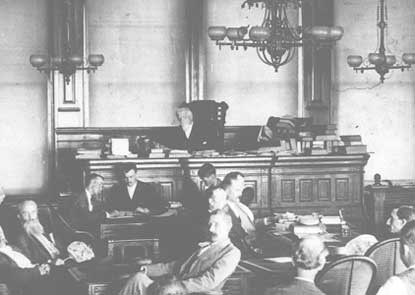 Judge Parker seated at his bench in courtroom on 6th Street