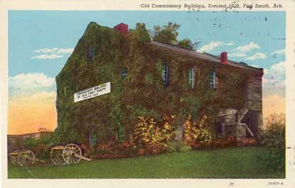 colorized postcard of Commissary with museum sign on building