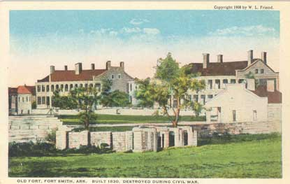 postcard of fort with walls and guardhouse in foreground, officers quarters in background