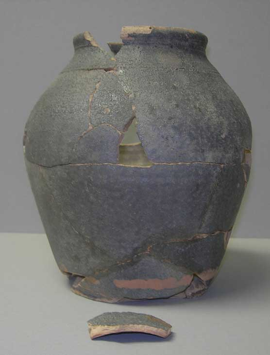 large earthenware jug that shows fragments pieced together