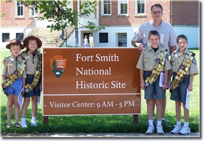 Veteran Jr. Rangers pose by the Fort Smith National Historic Site Welcome Sign.
