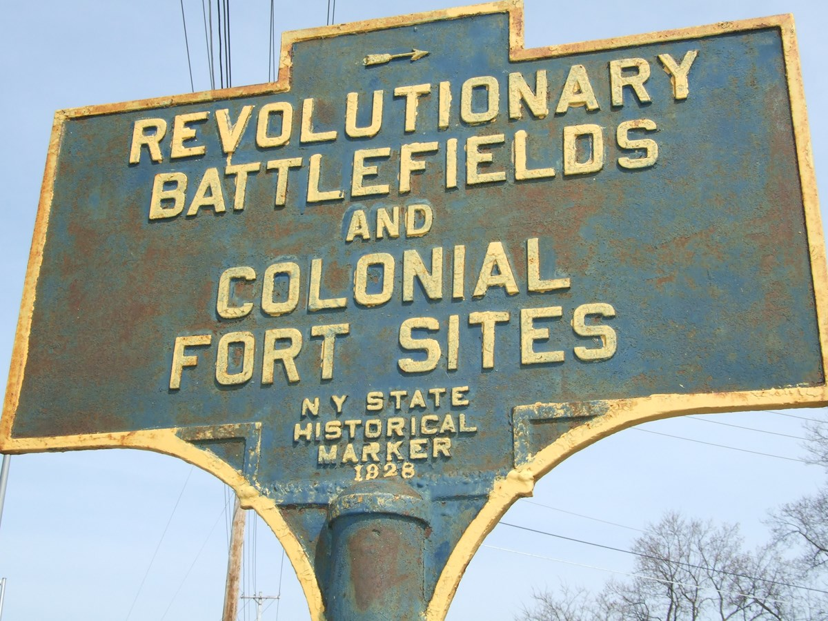 Blue and gold trimmed sign: REVOLUTIONARY BATTLEFIELDS and COLONIAL FORT SITES