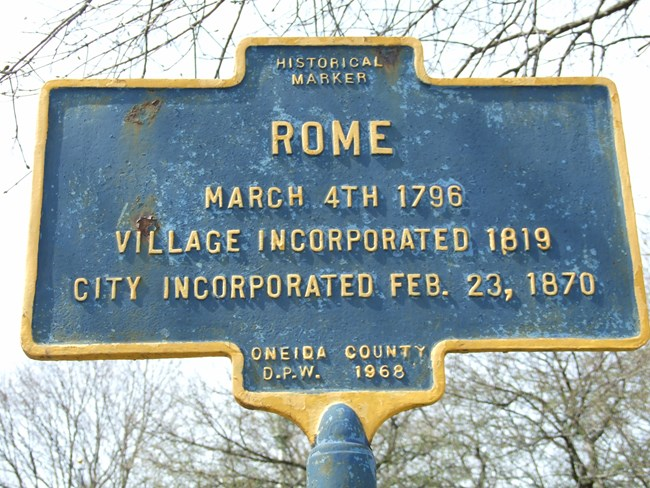 Blue gold trimmed sign: ROME March 4, 1796. Village incorporate 1819. City incorporated Feb. 23, 1870
