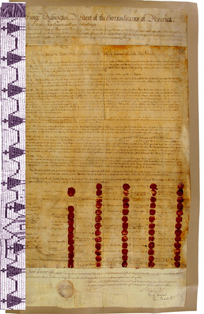 faded parchment paper with red ink seals & delicate hand writing, next to a delicate white & purple beaded belt of men holding hands