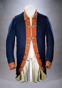 Jacket of superfine blue wool lined with linen & faced with red trim. It has silver buttons backed with bone &  silver lace on the buttonholes