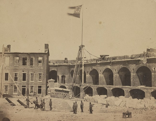 Interior shot from parade ground of Fort Sumter after the evacuation of Major Anderson's Union garrison. First National Confederate flag flying over fort.