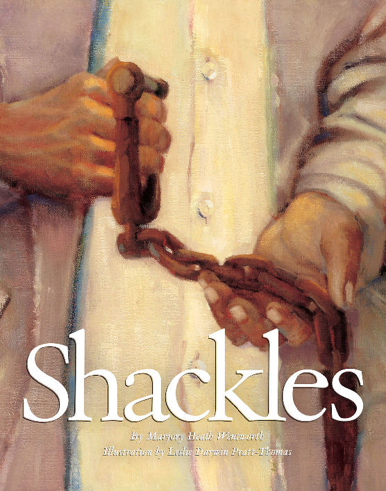 "Cover of the book ""Shackles' with a person holding a pair of slave shackles."