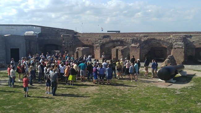 Crowd attending a ranger program on the parade ground at Fort Sumter