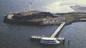 Aerial view of Fort Sumter with ferry boat docked.