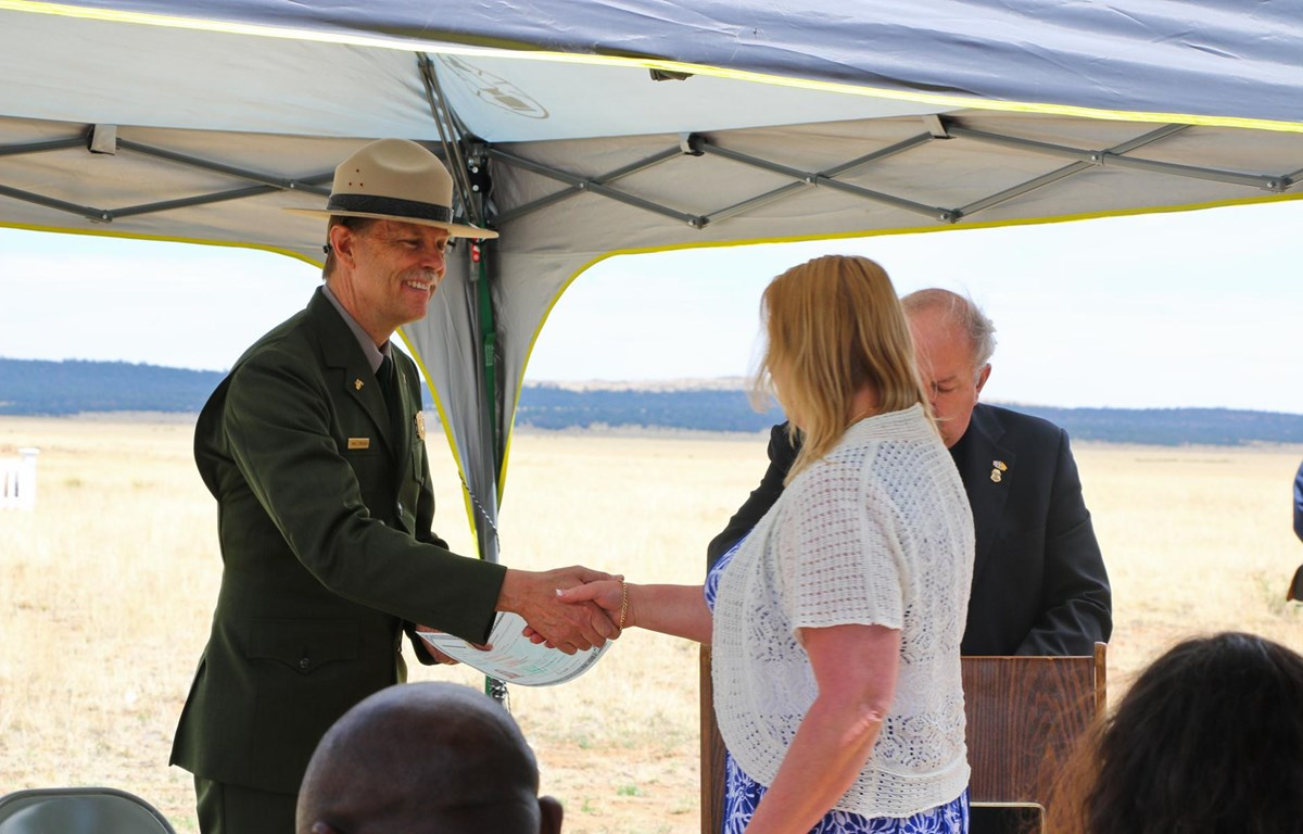 2014 Naturalization ceremony at Fort Union National Monument. Superintendent shaking hands.