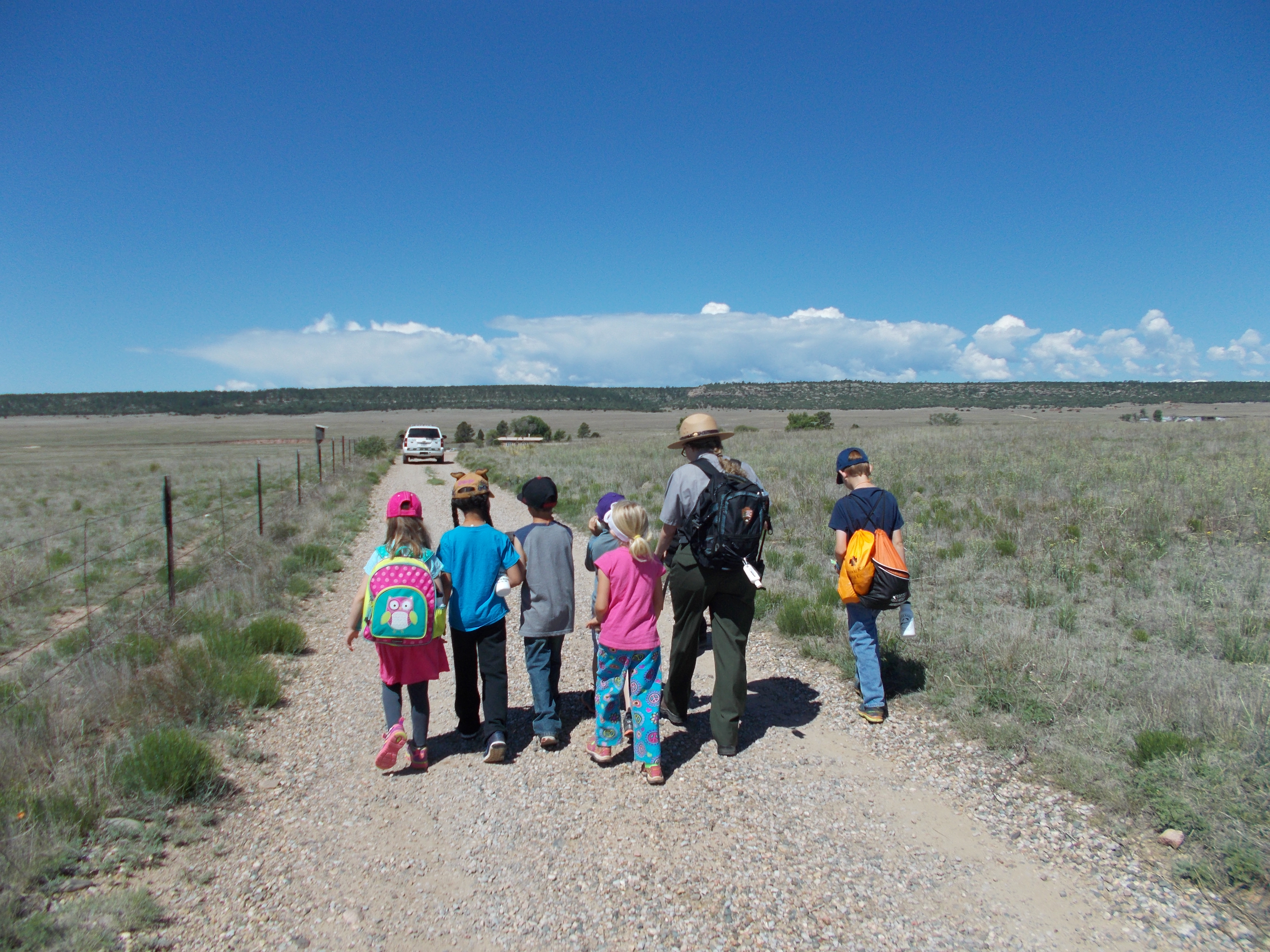 Ranger walking with students on trail