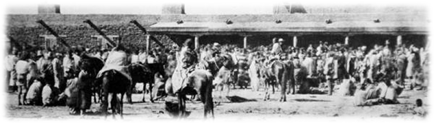 Group of Navajo in front of a building