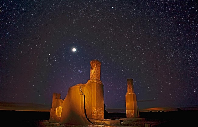 Stars, Constellations and Jupiter above adobe remnants