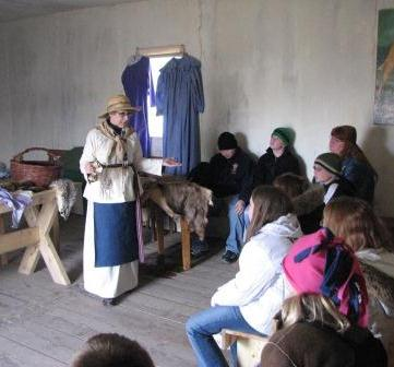 VIP Living History Program, Volunteer interpreting everyday life to a group of kids.