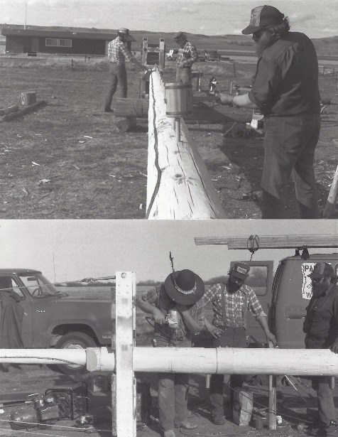 Two photographs. Top photograph: Three men work on the white painted flagpole as it lays on the ground. Bottom Photograph: One man drilling into same flagpole with power drill.