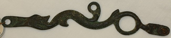 A brass sea serpent sideplate.