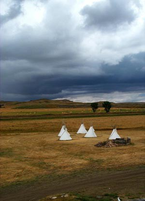 Tipis with threatening clouds approaching.