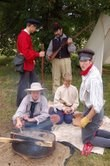 Re-enactment of sons and daughters of trappers at expedition campsite.