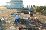 NCRI Archaeologist Cheryl Paddock and a volunteer screen for artifacts at American Camp in San Juan Island National Historical Park