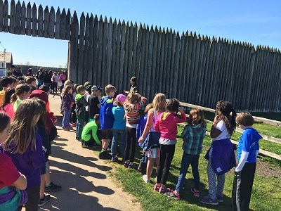 Ranger introduction of Spring Education Tour to students at entrance of Reconstructed Fort.