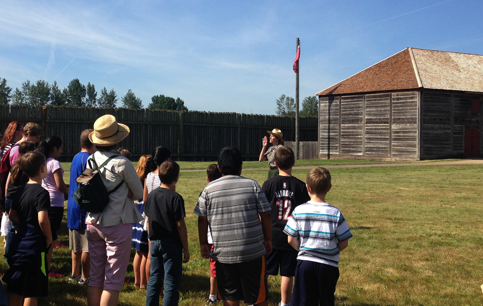 Ranger Julie welcomes and address school group for a field trip for the reconstructed fort at Fort Vancouver National Historic Site.