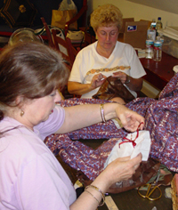 Image of volunteers sewing