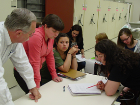 students gather around a table in the park's Archives & Reference Collection