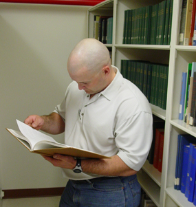 Student researcher in the Fort's library