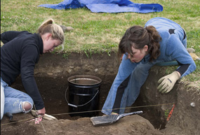 Students participate in an archaeological excavation onsite as part of the annual Archaeology Field School