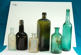 Six bottles of various sizes and colors from the excavation of the Sutler Store privy.