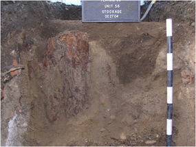 Image of the inside of a pit or trench dug by archaeologists