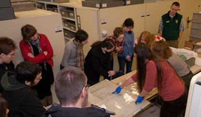 Field school students examine artifacts in the Fort Vancouver collection facility.