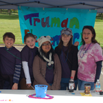 volunteers from Truman Middle School staff a table at a park special event