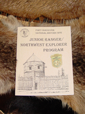Image of the fort's Junior Ranger booklet and badge
