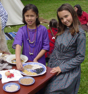 Image of two young volunteers at a special event
