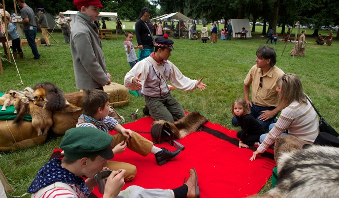 Students in the Young Engage School interpret the fur trade to the public at a special event.