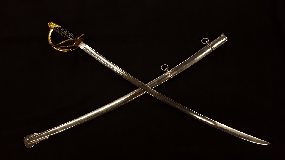 "Model 1840 Cavalry Saber ""Old Wrist-Breaker"" with metal scabbard. This sword is 44 inches long with a 35 inch blade and weighs approximately 2.5 pounds."