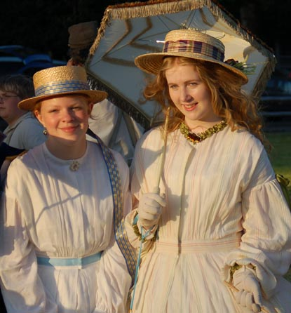 Young women in 1860s attire