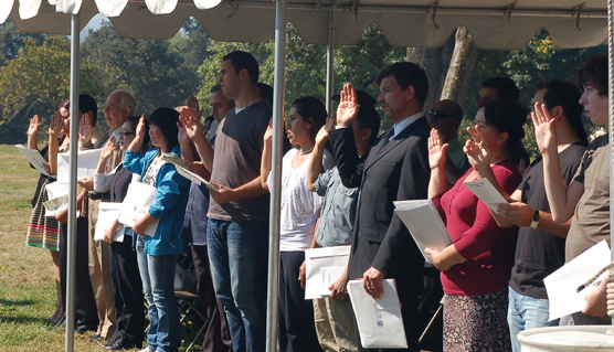 Candidates take the Oath of Citizenship at the 2012 ceremony at Fort Vancouver.