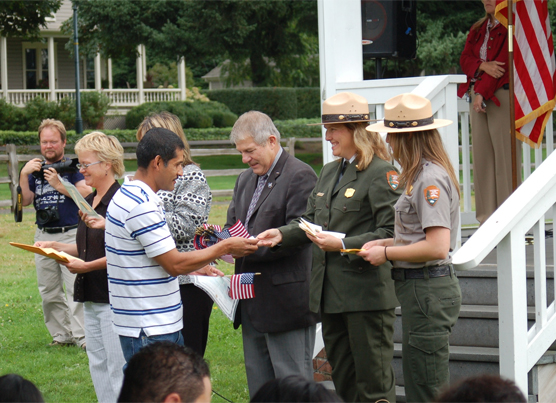 A new U.S. Citizen receives his Citizenship Certificate at Fort Vancouver in 2010