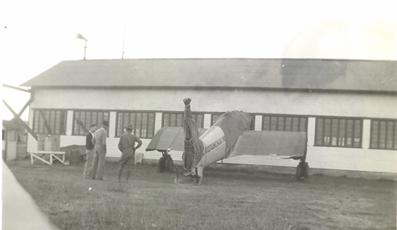 Historic black and white photo of the exterior of the historic hangar building at Pearson Air Museum