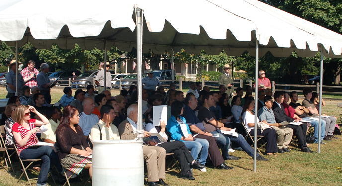 View of candidates for U.S. citizenship under at tent at the park's historic Parade Ground