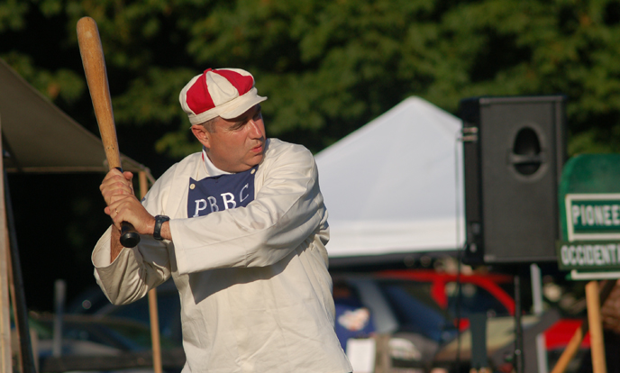 Photo of volunteer Bob Knight costumed as a member of the Pioneer Base Ball Club of Portland.